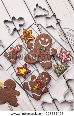 Gingerbread cookies and on vintage white table - stock photo