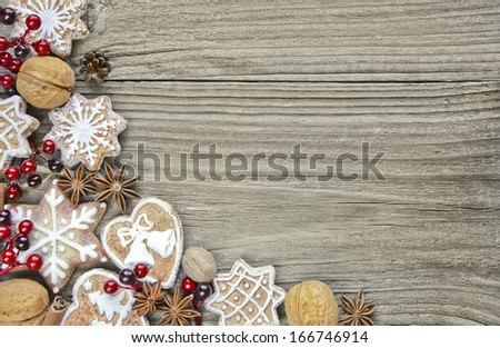 Gingerbread cookies and spices on the wooden background - stock photo