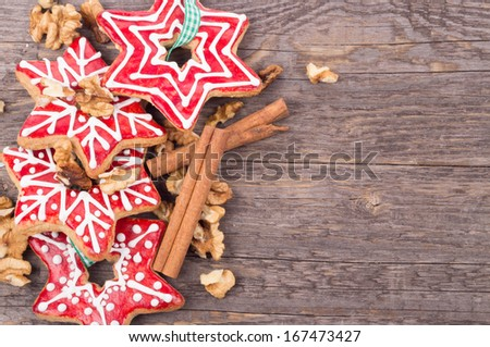 Gingerbread cookies, christmas decoration on wooden background