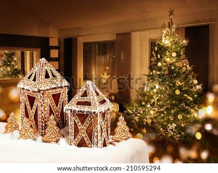Gingerbread cookies cottages Christmas tree room background - stock photo