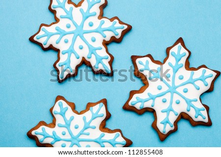 Gingerbread cookies decorated with light blue and white - stock photo