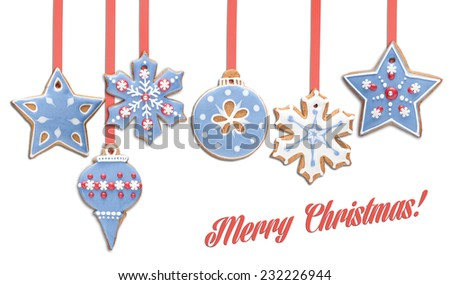 Gingerbread cookies decorated with royal icing hanging in a row, isolated on white. - stock photo