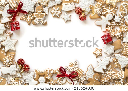 Gingerbread cookies frame on white background. Snowflake, star, man, angel shapes. - stock photo