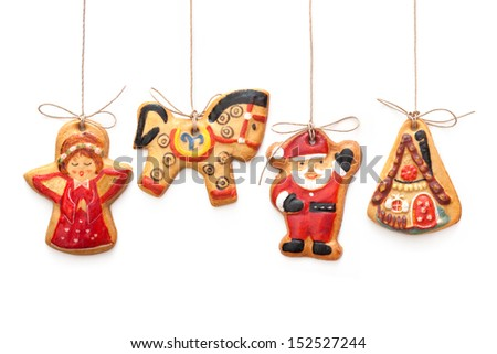 Gingerbread cookies hanging  isolated over white background - stock photo