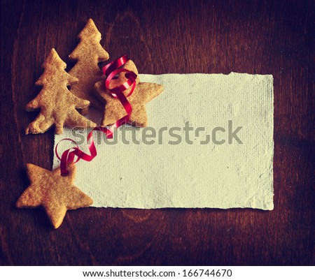 Gingerbread cookies in christmas tree shape. Christmas Holiday Background with copy space and red bow. - stock photo