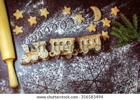 Gingerbread cookies in the form of train. Christmas cooking - stock photo