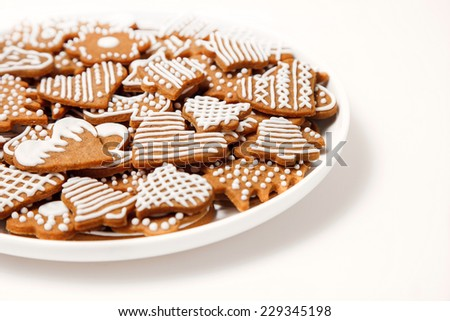 Gingerbread cookies in the white plate  - stock photo