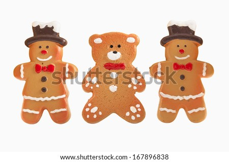 Gingerbread cookies isolated over white background with clipping path.
