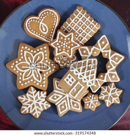 Gingerbread cookies on a plate. Christmas decoration. - stock photo