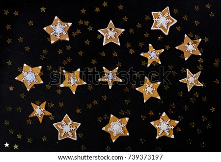 Gingerbread cookies on a wooden background
