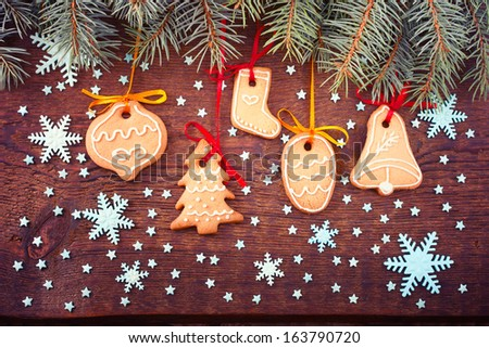 Gingerbread cookies on wooden background. Christmas card. Free space for your text - stock photo