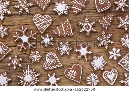 Gingerbread cookies over wooden background - stock photo