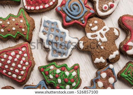 Gingerbread cookies over wooden background