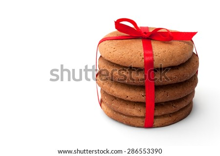 Gingerbread cookies pile with red ribbon isolated on white background - stock photo