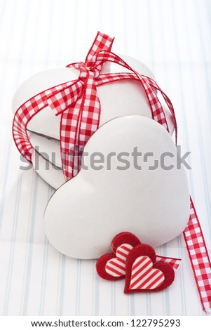 Gingerbread cookies tied with ribbon and two decorative heart