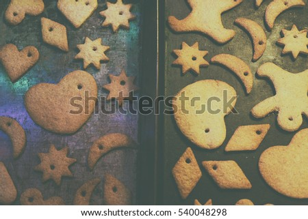 Gingerbread cookies with strings lie on baking trays. In a moment they hung on the Christmas tree/Christmas gingerbread cookies on baking trays
