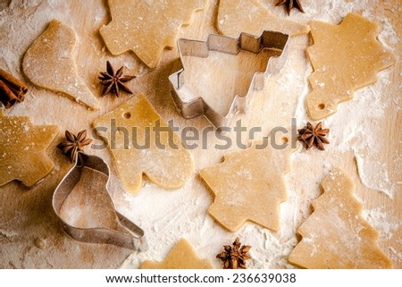 Gingerbread dough for Christmas cookies and cookie cutters. - stock photo