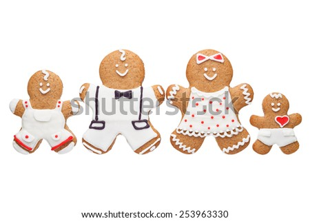 Gingerbread family on white background - stock photo