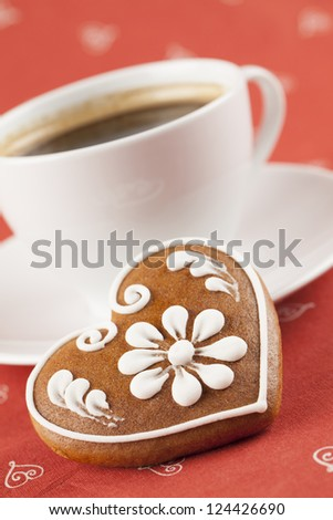 Gingerbread heart and a cup of coffee. Shallow dof - stock photo