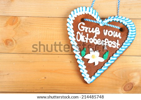 Gingerbread heart on wooden ground - stock photo