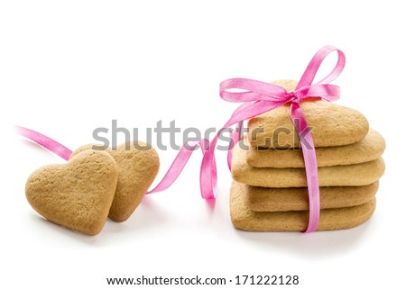 Gingerbread hearts bundle with pink bow. Isolated on white background. - stock photo