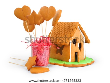 Gingerbread house and gingerbread isolated on white background