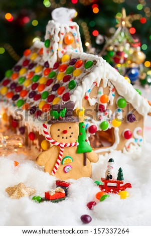 Gingerbread house and snowmen - stock photo