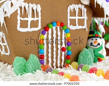 Gingerbread house. Closeup of gingerbread house and snowman - stock photo