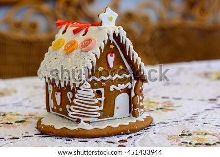 Gingerbread House in the snow.