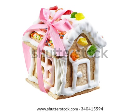 Gingerbread house isolated on white - stock photo