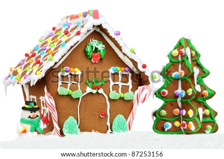 gingerbread house isolated on white background with Christmas three and snowman. - stock photo