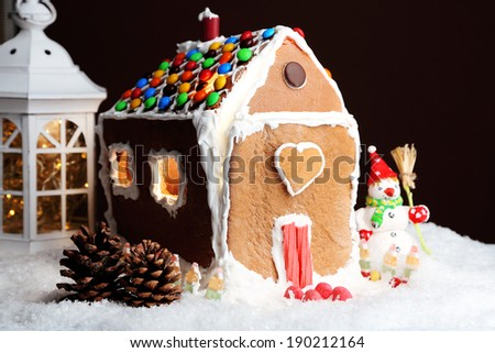 Gingerbread house on brown background - stock photo