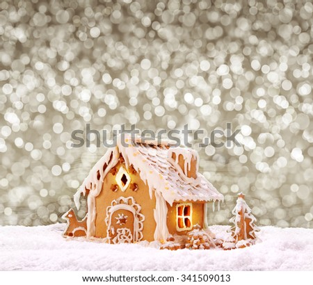 Gingerbread house on the grey bokeh  background.Christmas background.