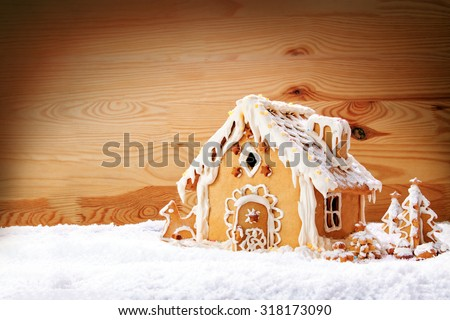 Gingerbread house on the wooden background.Christmas background.