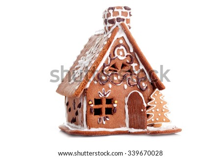 Gingerbread house on white background - sweet food - stock photo