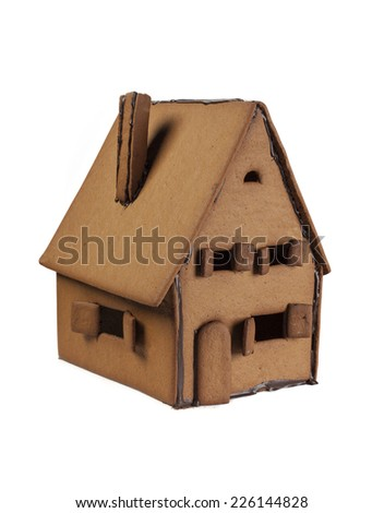 Gingerbread house ready for decorating on white background - stock photo