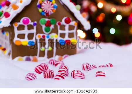 Gingerbread house with round  peppermint candies.