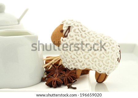 Gingerbread  lamb cookies on white background - stock photo