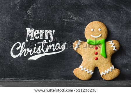 Gingerbread man against chalkboard background