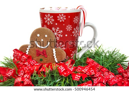 gingerbread man and hot chocolate drink in Christmas ribbon