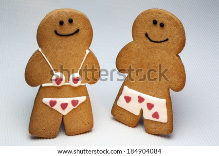Gingerbread man and woman. Gingerbread dates back to the 15th century and the first documented instance of figure-shaped gingerbread biscuits was at the court of Elizabeth I of England.