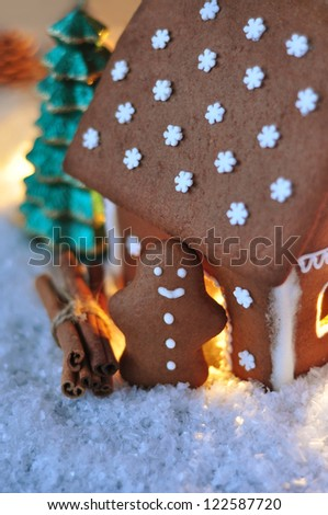 Gingerbread man by the Gingerbread House - stock photo