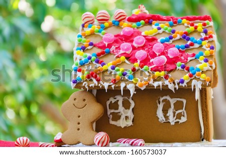 Gingerbread man by the house on the green phone