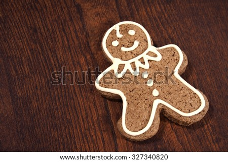 Gingerbread man - cookie, over a wooden table. - stock photo