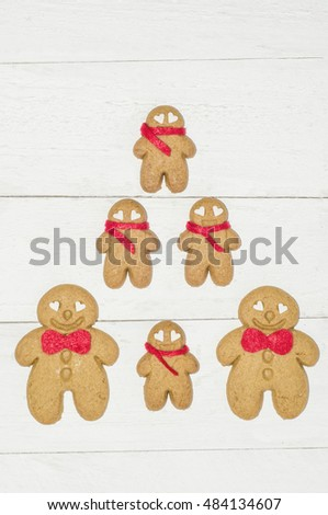Gingerbread man is a biscuit or cookie made of gingerbread in the shape of a man or a boy / Festive cookie / Ideal cookies for christmas,new year and halloween day theme