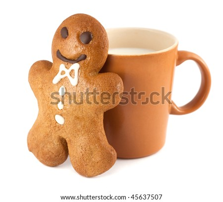 Gingerbread man with a cup of milk isolated on white - stock photo
