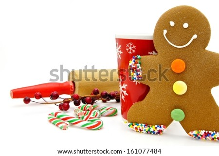Gingerbread Man with festive mug and rolling pin - stock photo