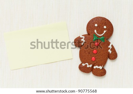 Gingerbread Man with memo paper - stock photo