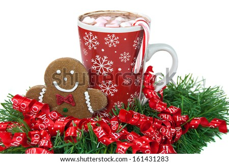 gingerbread man with mug of hot chocolate and candy cane