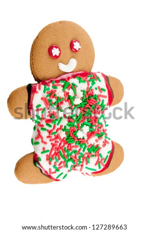 gingerbread man with white icing for his clothes which are covered with Christmas holiday green and red colored sprinkles. Background is isolated white.